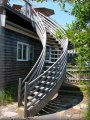 GO Green products include this recovered (dead head) cypress exterior deck staircase - one of many Unique Spiral Stairs - model 14' QT Series Exterior with optional multi rail system