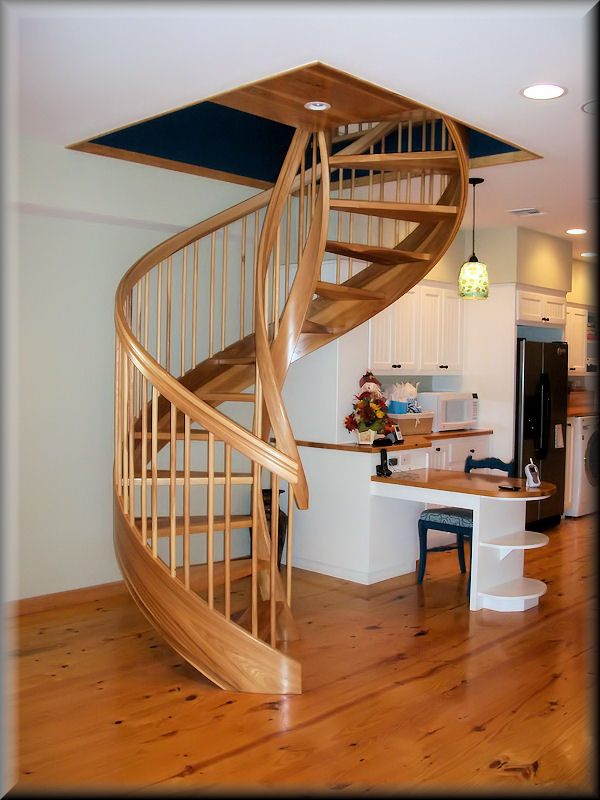 Wooden Spiral Stairs, custom made by Unique Spiral Stairs