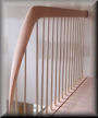 Flowing rail fitting with Nickle/Silver balusters